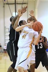 American Heritage Forward Lucas McCormick secures a rebound