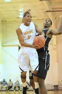 Heritage's Jason Massey drives against Joel Embiid