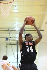 Joel Embiid grabs a rebound