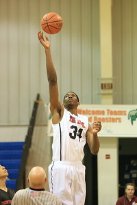 Joel Embiid takees the opening tip against Northeast