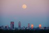 "Photographer Jacob Zimmer captures the full ""Supermoon"" rising over the Downtown Louisville, KY skyline from across the Ohio River in Southern Indiana while the setting sun reflects off the glass windows of the city skyscrapers. An airline jet can be seen crossing in front of the moon descending to the Louisville International Airport. Monday, September 8, 2014."
