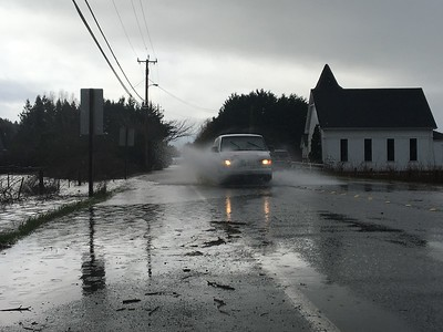 Flooding along Old Arcata Road in Bayside does not deter some vehicles on Friday. (Heather Shelton - The Times-Standard)