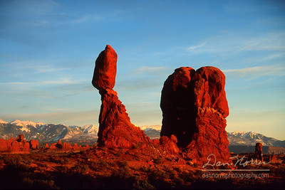 Fiery sunset at Balanced Rock Arches National Park near Moab, Utah