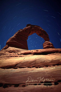 Delicate Arch with North Star and Star Trails Arches National Park near Moab, Utah 5-minute exposure with full moon on ISO 50 film