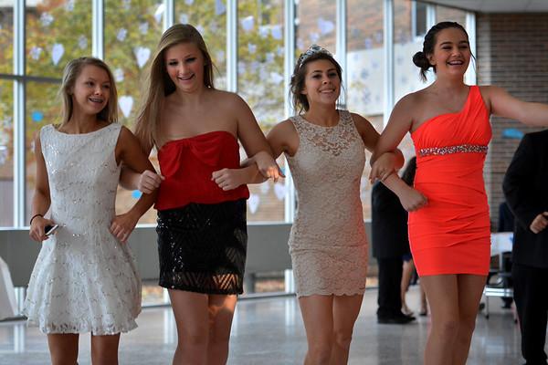 Left to right, Kerigan Randall, age 15, Natasha Corcoran, 14, Abbi Zartman, 15, and Ainsley Dalton, 12, circle the dance floor doing a country style dance.