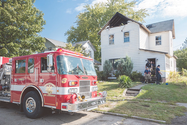 Firefighters and fire investigators exit the home at 514 12th street on Monday morning after an early morning fire at the residence. The investigation into the cause of the blaze continues. Fran Ruchalski | Pharos-Tribune