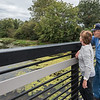 "Jane Cotner and Robert ""Smokie"" Kendall take a moment from their evening walk to look out over the Eel River from the walking bridge at Riverside Park on Tuesday. Fran Ruchalski 