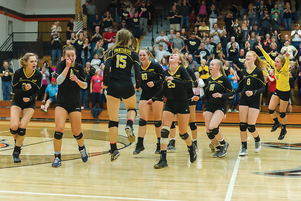 The Pioneer Panthers volleyball team celebrate their victory after scoring their final point to win the third set and the championship. Pioneer defeated Lakewood Park Christian in 3 sets to win the Volleyball Regionals on Saturday October 21, 2017 at Culver Community High School. Fran Ruchalski | Pharos-Tribune
