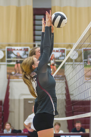 The Lady Warriors successfully block one of the Lady Berries attempts to score in volleyball action as Logansport traveled to Winamac on Thursday night. Fran Ruchalski | Pharos-Tribune