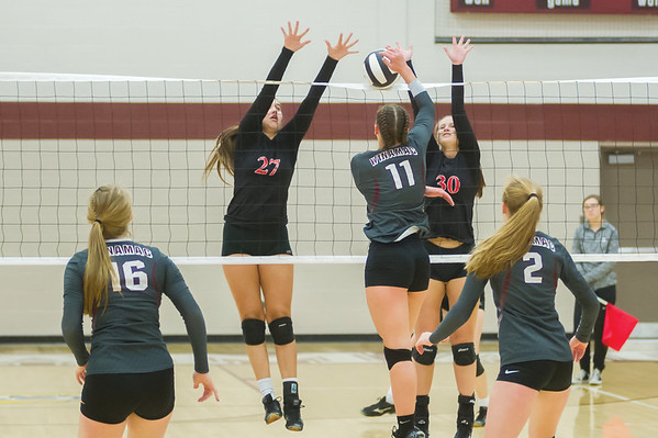 Lady Warrior Isabelle Dotlich (11) puts the ball between Lady Berries Brooke Veasey (27) and Lauren Shilts (30) in volleyball action at Winamac on Thursday night. Fran Ruchalski   Pharos-Tribune