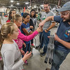 James Williamson, right, gives each of the children a wire bat to take home with them after they watched them being made.  Myers Spring hosted Manufacturing Day at their plant on Water Street on Friday to show elementary school children what it's like to work in a factory. Fran Ruchalski | Pharos-Tribune