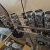 After labels are applied and heat sealed to empty aluminum beer cans, they come down a conveyor tol be packed on skids and taken to the breweries where the beer will be pumped in and they will be capped and ready for sale. Fran Ruchalski | Pharos-Tribune