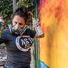 Mollie Graybeal clowns around as she gets ready to put some finishing touches on a seascape mural she painted in the alley. Fran Ruchalski | Pharos-Tribune