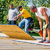 After the joists have been installed in the press box at the baseball field at  Fairview Park on Saturday morning, Jason Pearson, center, drops the next panel for the sub-floor into place, while Rob Smith and Eric Wickersham wait to help secure it. Fran Ruchalski | Pharos-Tribune