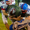 Warriors Austin Brandt (23) is wrapped up by Comets Gavin Hickle (44) Colton Welker (35) and Kasey Ault (40) in the second half. Winamac went on to defeat Caston by a score of 47-8. Fran Ruchalski   Pharos-Tribune