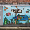 The first mural Mollie Graybeal painted on the air conditioning unit behind her family's furniture business. Once her father and uncle saw it, they asked her to do more to bring more life to the area. Fran Ruchalski | Pharos-Tribune