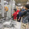 Students from Fairview Elementary watch as this machine fashions a bat from a spool of wire. The students were then given a bat to take home with them. Myers Spring hosted Manufacturing Day at their plant on Water Street on Friday to show elementary school children what it's like to work in a factory. Fran Ruchalski | Pharos-Tribune