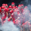 The Lewis Cass Kings come out of the smoke-filled tunnel for their game against Northwestern earlier this season. Fran Ruchalski | Pharos-Tribune