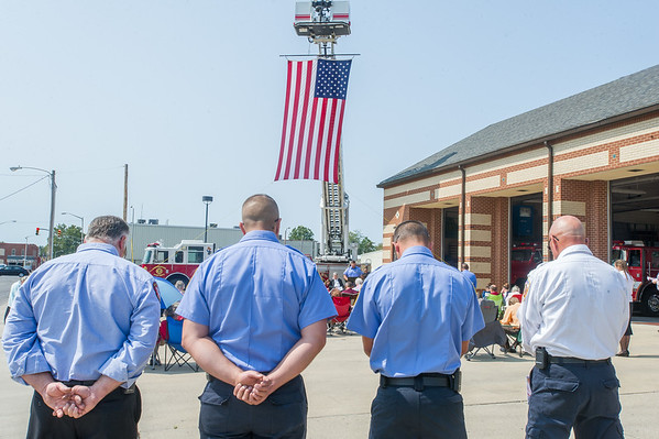 Firefighters from several Cass County fire companies bow their heads for prayers of intercession during the 16th anniversary 911 Remembrance Ceremony held at the Logansport Central Fire Station on Sunday afternoon. Fran Ruchalski | Pharos-Tribune