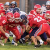 Northwestern's Nick Sottong (15) is surrounded by a horde of Cass tacklers on a run  in the second quarter.  The Kings defeated the Tigers by a score of 30-15 at Lewis Cass High School on Friday, Sept. 8, 2017.  Fran Ruchalski | Pharos Tribune