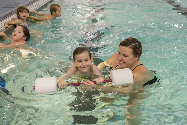 Swim Instructor Katy Kincaid teaches Alexander Parker how to float and kick his legs as part of the swim training for kindergarten students at the pool at Lewis Cass High School. Fran Ruchalski | Pharos-Tribune