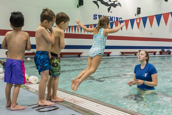 Swim Instructor Lilly Schnitz encourages Autumn Rombold to jump into the pool as part of the swim training for kindergarten students at the pool at Lewis Cass High School. Fran Ruchalski | Pharos-Tribune