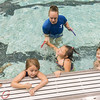 Swim Instructor Cat Sehr has Kaitlynn Alspaugh grab for a ring under the water and come up with it as part of the swim training for kindergarten students at the pool at Lewis Cass High School. Fran Ruchalski | Pharos-Tribune