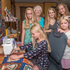 Featured quilter at the Carroll County Harvest of Quilts show, Sue Hodge, center, is surrounded by five of her granddaughters who also have a passion for quilting. The Hurst sisters are Adrianna, 11 (seated at the sewing machine), Donna, 13 (from left), Miriam, 7, Justine, 17, Anabel, 14, and Miriam, 7. They are the fifth generation to be involved in quilting. Fran Ruchalski | Pharos-Tribune