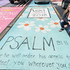 Pioneer senior Lexi Baker poses next to her personally painted parking place at the school on Monday afternoon. About 30 seniors painted their own parking places as part of a fundraising program at the school. Fran Ruchalski | Pharos-Tribune