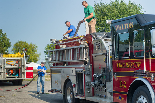 The Walton Community Fire Dept. recently acquired a newer engine to replace their current E2. David Noel, left, hands a hose from the old truck to Chief Brett Shupperd and Ty Rowan on the new E2 engine. Fran Ruchalski | Pharos-Tribune