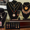 Some of the many jewelry pieces Elaine Burkett has designed and constructed on display in her home. Burkett will be one of the artists at Art on the Avenue this Saturday. Fran Ruchalski | Pharos-Tribune