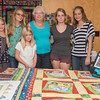 Featured quilter at the Carroll County Harvest of Quilts show, Sue Hodge, center, is surrounded by five of her granddaughters who also have a passion for quilting. From left, The Hurst sisters are Adrianna, 11, Donna, 13, Miriam, 7, Justine, 17, and Anabel, 14. They are the fifth generation to be involved in quilting. Fran Ruchalski | Pharos-Tribune