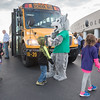 170 Kindergarteners from Rochester and Caston elementary schools are welcomed to the Ivy Tech Logansport campus by the college's wolf mascot. The children were there for the Promise Indiana: Walk Into My Future event where they learned about skills training and professions that might interest them in the future. Fran Ruchalski | Pharos-Tribune