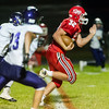 Northwestern defenders are unable to stop Cass quarterback Brady Johnson (32) on a run for the Kings last score of the night late in the fourth quarter.  The Kings defeated the Tigers by a score of 30-15 at Lewis Cass High School on Friday, Sept. 8, 2017.  Fran Ruchalski | Pharos Tribune