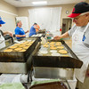 Greg Packard, from left, Mike Morphet, Ray Bean and Mike Fincher man the pancake grills for the 52nd Annual Cass County Pancake Day at the 4H Fairgrounds in Logansport on Saturday morning. Fincher stated that by 8AM, they had made 6413 flapjacks and it was the only place in the state where you could get Mickey Mouse pancakes. The event benefits the 4H Association and is sponsored by the Cass County Chamber of Commerce. Fran Ruchalski | Pharos-Tribune