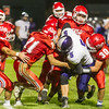 Northwestern's Ethan Breisch (5) can't escape from a horde of Cass tacklers on a run  in the fourth quarter.  The Kings defeated the Tigers by a score of 30-15 at Lewis Cass High School on Friday, Sept. 8, 2017.  Fran Ruchalski | Pharos Tribune