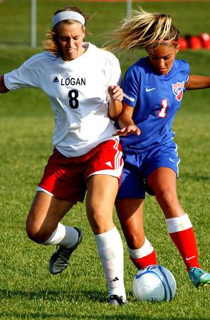 P-T photo | Steve Summers<br /> BALL BATTLE: Logansport senior Rachel Jennings (8) battles Kokomo's Cheyene Eltringham during semi final round of the IHSAA Girls Sectional Soccer tournament at Logansport High School Thursday.