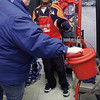 P-T photo | Angi Turnpaugh<br /> Salvation Army bell ringer Michael VanVynckt watches as Deanna Lambert of Camden makes a donation at Rural King on Saturday.