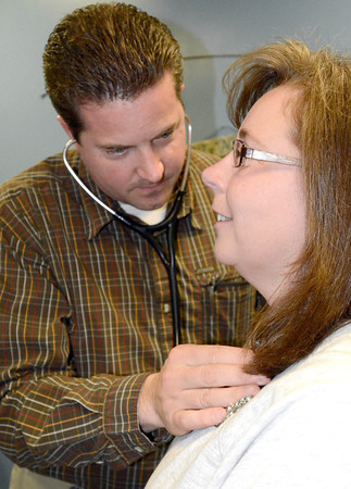 Dr. Jordan Dutter of Flora Family Medicine listens to Stephanie Martin's heart and lungs during an appointment Tuesday 4/15. (AP photo/Logansport IN Pharos-Tribune)