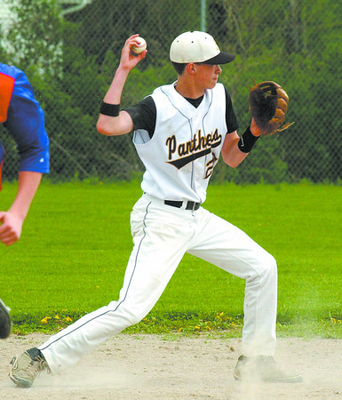 Tucker Waddups throws to second base in a fielders choice during first inning action versus Caston Friday.