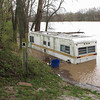 Flood waters from the Wabash River surround a trailer along County Road 50 South.