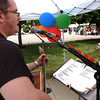 P-T photos | Steve Summers <br /> Local musican Jason McKeever serenades the crowd at Celebrate Logansport Day downtown. Puppet shows, sidewalk chalk drawing, face painting, drawings and strawberries and shortcake highlighted the festivites.