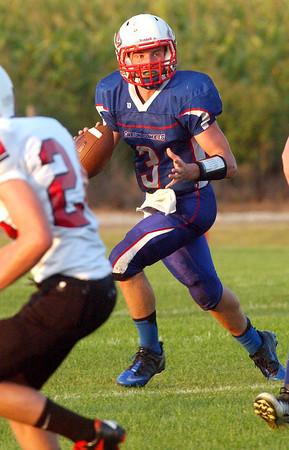 Caston quarterback Quentin Douglass looks down field as he rolls out to pass versus Frontier