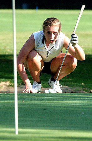 Chelsey Henn sizes up her putt.