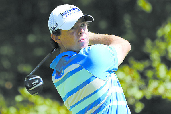 Rory McIlroy, of Northern Ireland, tees off on the fourth hole during the final round of the Deutsche Bank Championship PGA golf tournament at TPC Boston in Norton, Mass., Monday, Sept. 3, 2012. (AP Photo/Michael Dwyer)