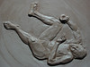 This is a relief sculpture,which I made for a fundraising platter for Seward Clay Studio in Seattle, 2010.  It was inspired by the pose for a life sized sculpture of a man falling down laughing.