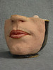 """Mug Mug"",  actually a pitcher, made of facial features I sculpted as demonstration for a Portrait sculpture class."