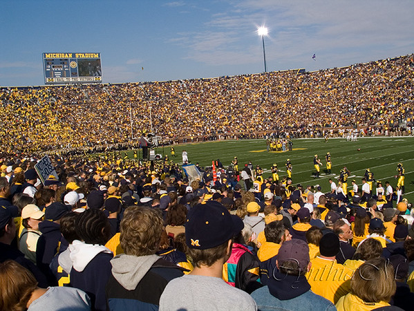 Over 110,000 people.  Go Blue, wear maize.