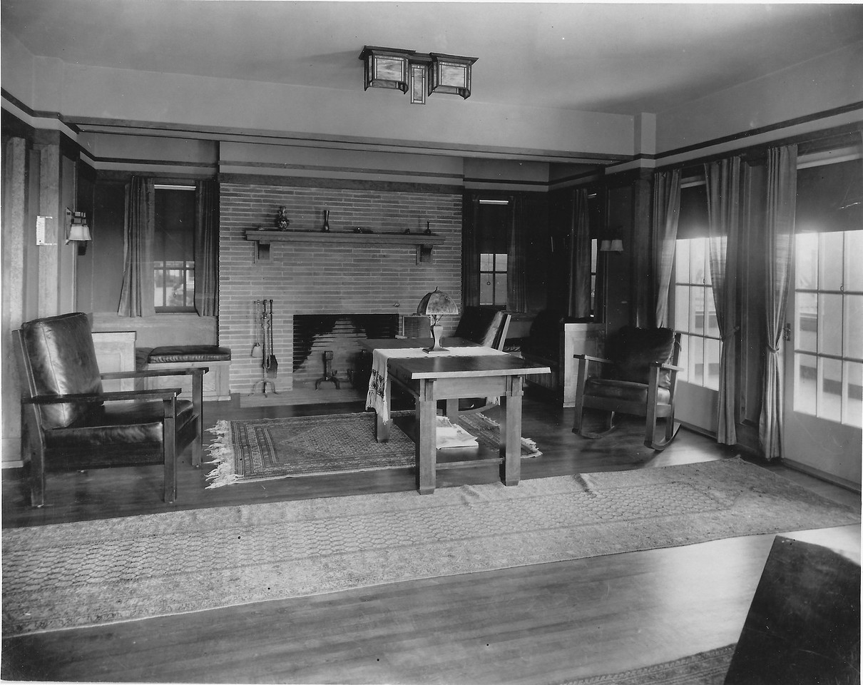The living room shortly after completion in 1911.  The original ceiling sconce is no longer there. The built in window seating on the right encloses one of the radiators. On the left it was removed at some point. Using this photo and the existing built in it was re-created. The brick is the horizontal brick found in many of the Frank lloyd Wright houses.