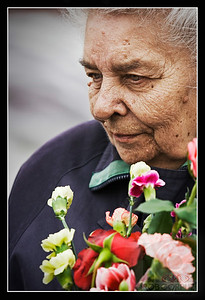 OLD WOMAN HOLDING FLOWERS, - Moscow, Russia